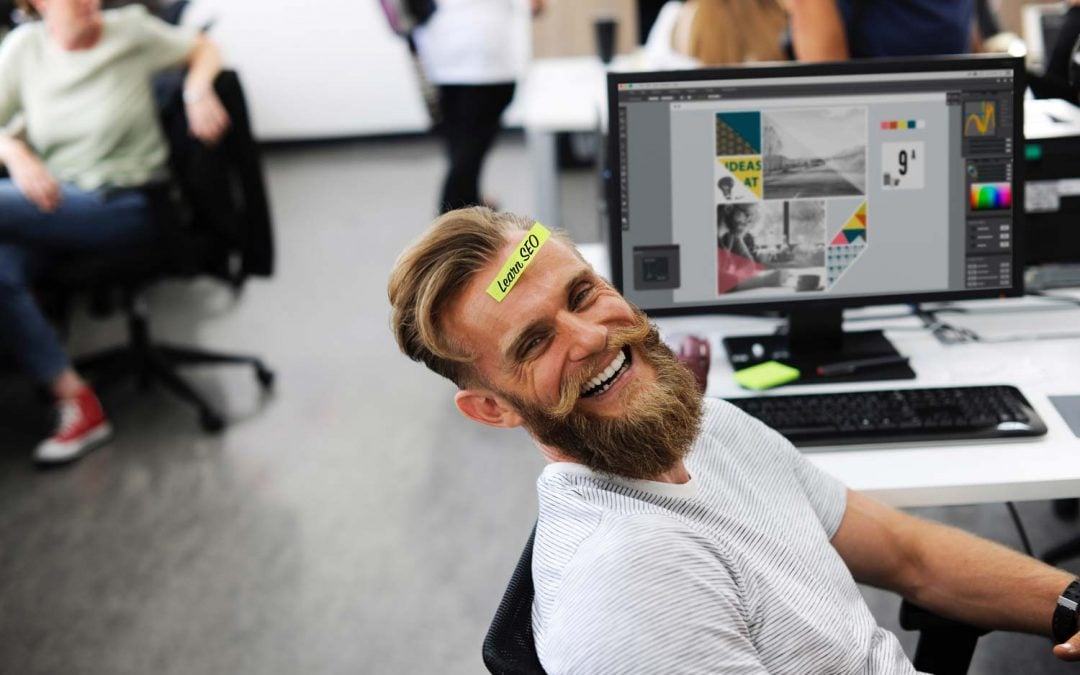Happy guy with Learn SEO sticker on his head